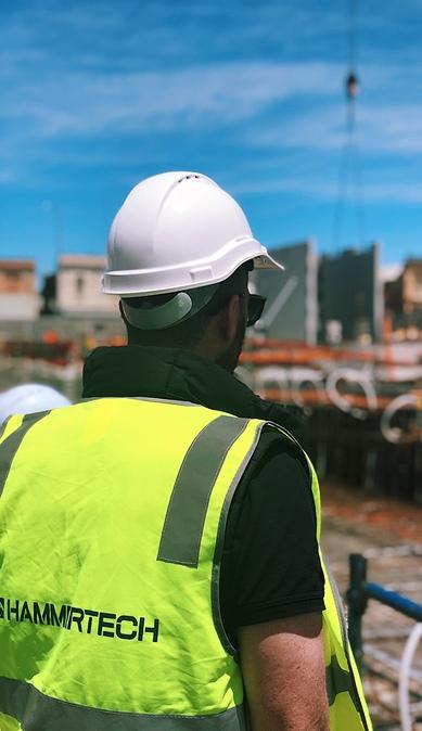 construction-crew-member-in-hammertech-safety-vest-389x674