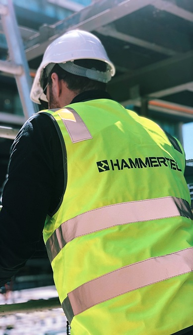 hammertech team member in safety vest